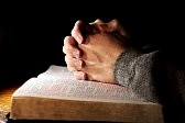 3102870-bible-praying-hands-man
